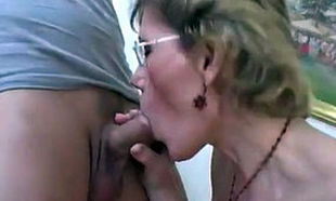 Grannie in glasses takes 2 young woman..